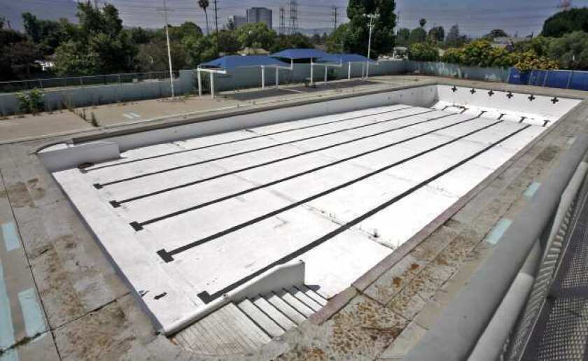 Crews dive into pool project