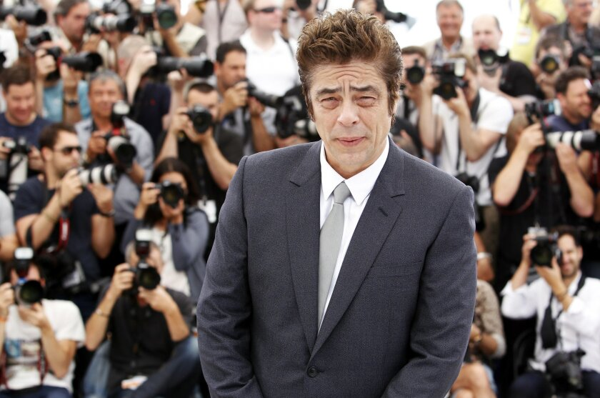 Actor Benicio del Toro poses for photographers during a photo call for the film Sicario, at the 68th international film festival, Cannes, southern France, Tuesday, May 19, 2015. (AP Photo/Lionel Cironneau)