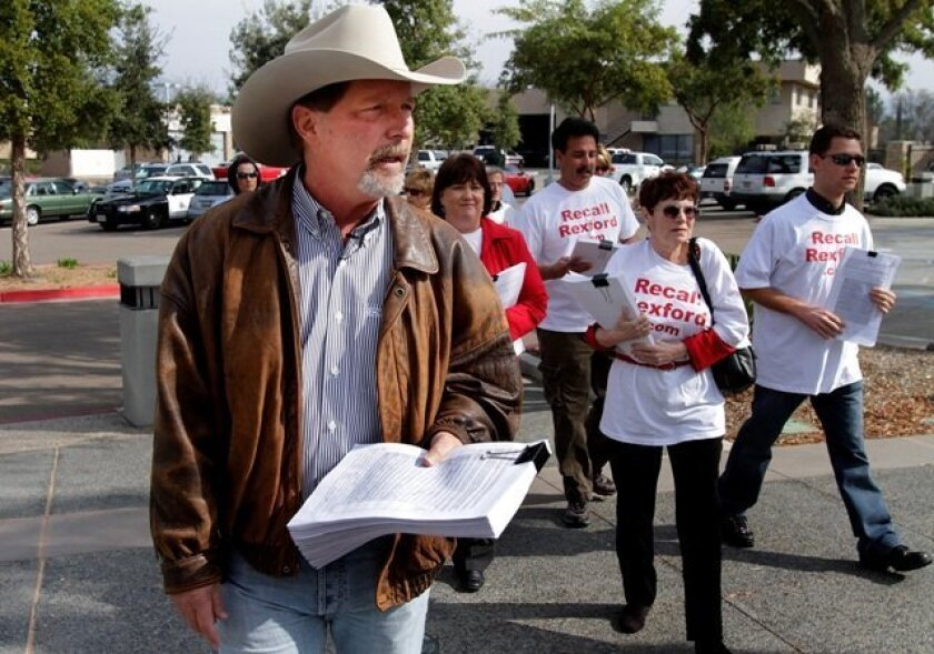 Steve Vaus and other supporters of an effort to recall Poway Councilwoman Betty Rexford headed to the City Clerk's Office with petition signatures yesterday.