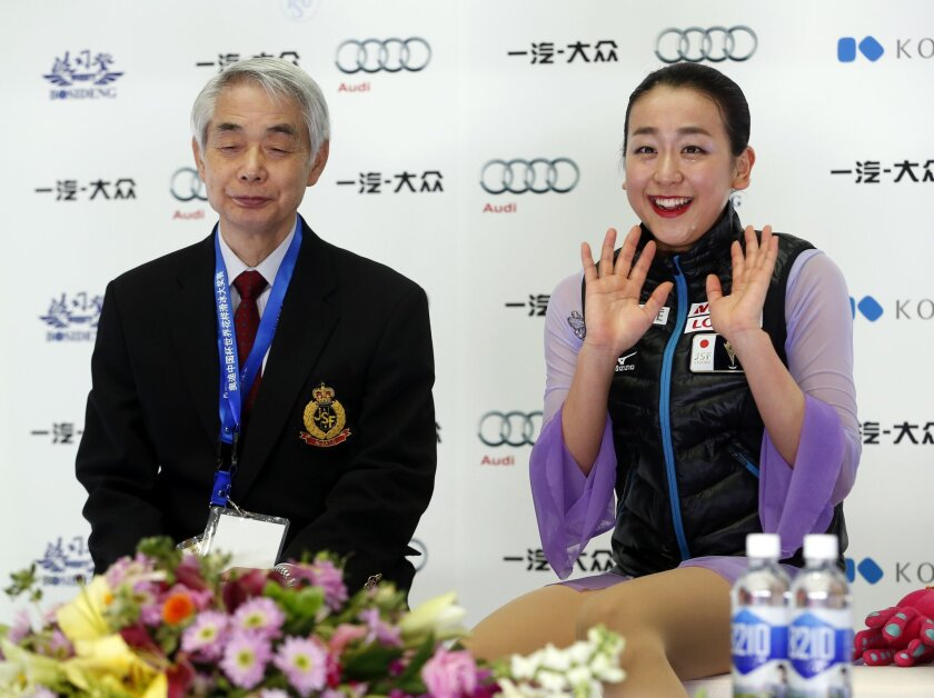 Japan's Mao Asada waves after competing in the Ladies Free Skating program during the ISU Grand Prix of Figure Skating at the Capital Gymnasium in Beijing, China, Saturday, Nov. 7, 2015. (AP Photo/Mark Schiefelbein)