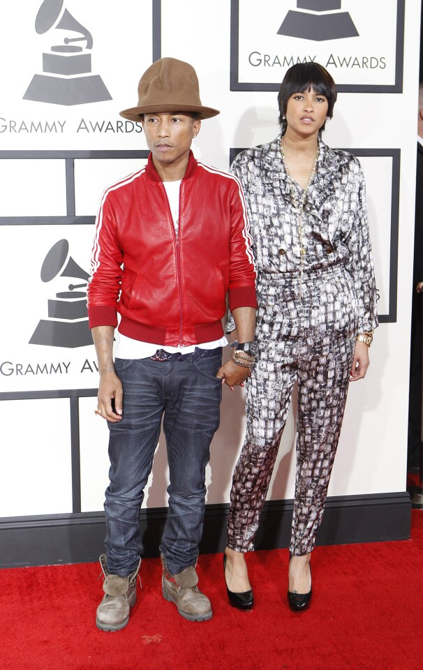 Pharrell Williams and date on the red carpet.