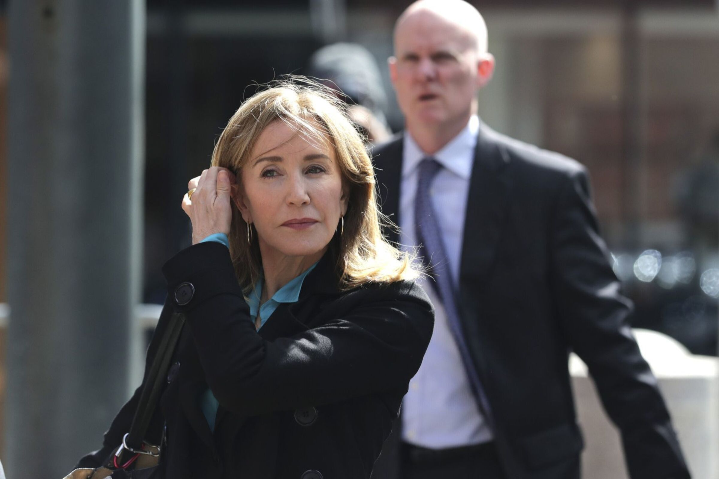 Actress Felicity Huffman arrives at federal court in Boston in April to face charges in the nationwide college admissions bribery scandal. She later pleaded guilty to a fraud conspiracy charge.