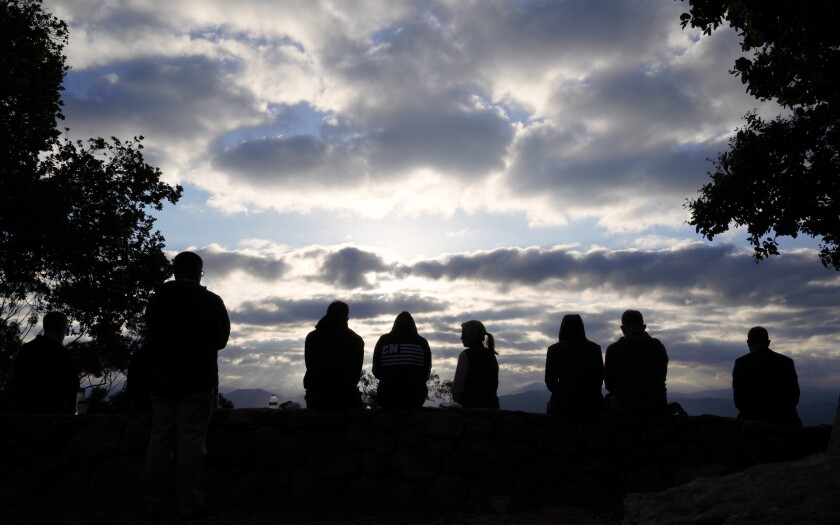 During this past Sunday's annual annual Easter Sunrise Service held on Mount Helix, a few chose to sit at the very top of the amphitheater.