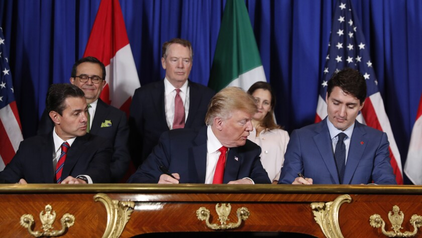 Mexican President Enrique Peña Nieto, President Trump and Canadian Prime Minister Justin Trudeau put their signatures on their countries' new trade deal Friday.