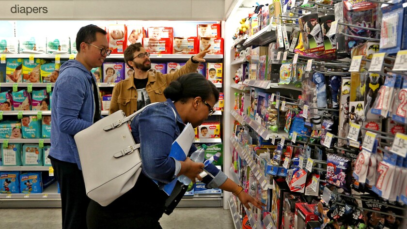 Chay, left, Koren, center, and Mulokwa at a Walgreens in Hollywood.