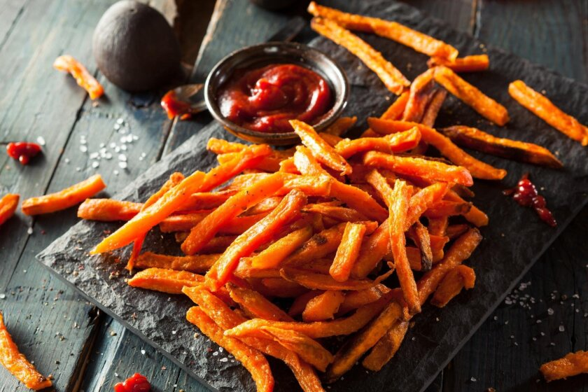 Lighten up your fries by tossing strips of yams in olive oil, salt and chili powder then bake until crisp.