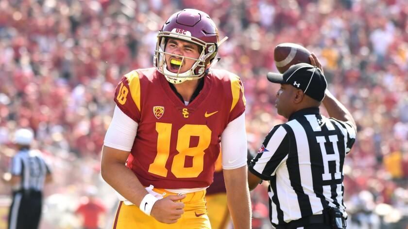 USC quarterback J.T. Daniels celebrates his first touchdown pass against UNLV at the Coliseum.