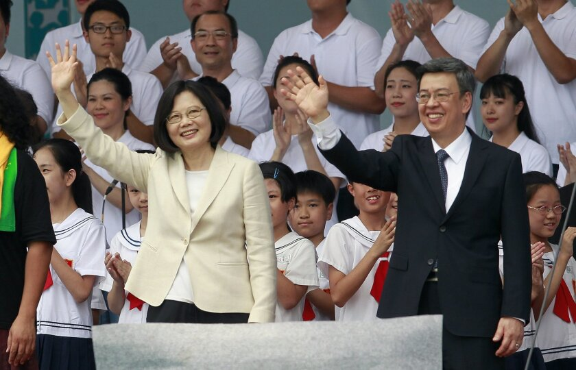 FILE - In this May 20, 2016 file photo, new Taiwan's President Tsai Ing-wen, left, and Vice President Chen Chien-jen wave during their inauguration ceremonies in Taipei, Taiwan. Taiwan's foreign minister says on Thursday, May 26, President Tsai will visit diplomatic allies Panama and Paraguay next