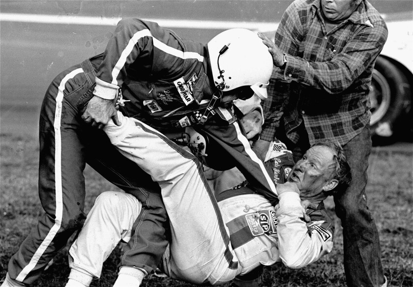 Bobby Allison (l) stands over Cale Yarborough after a collision between Yarborough and Bobbie's brot