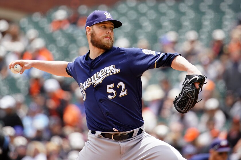 Former Milwaukee Brewers pitcher Jimmy Nelson has agreed to a deal with the Dodgers.