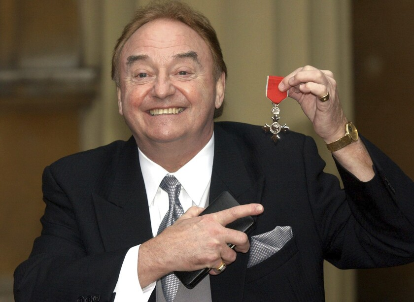 Gerry Marsden holds his order of the British Empire award in 2003. The lead singer of Gerry and the Pacemakers died.
