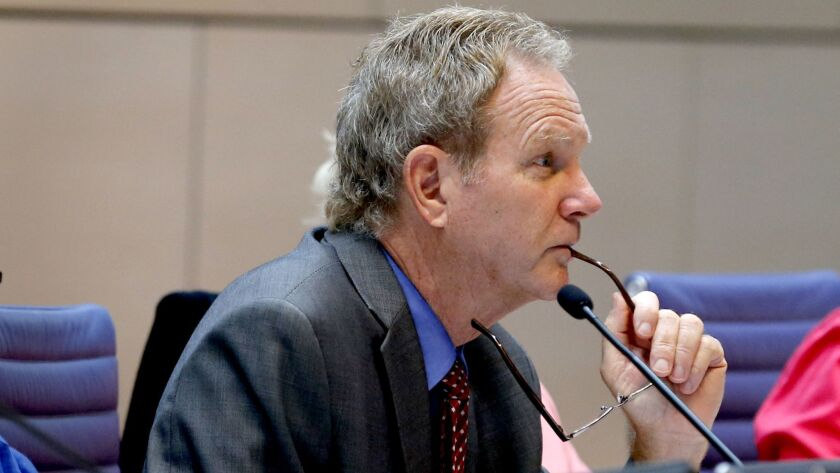 Steve Kinsey listens to comments during a California Coastal Commission hearing in 2016. Kinsey was recently fined $30,300 for rules violations.