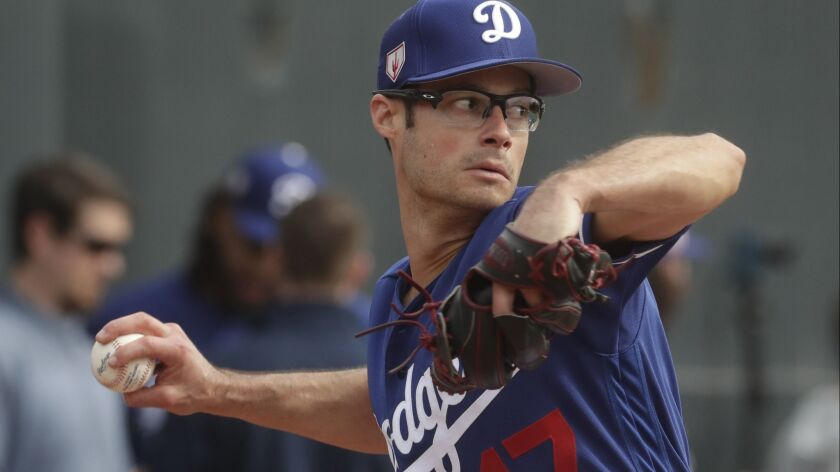 Los Angeles Dodgers' Joe Kelly throws during a spring training baseball workout Wednesday, Feb. 13,