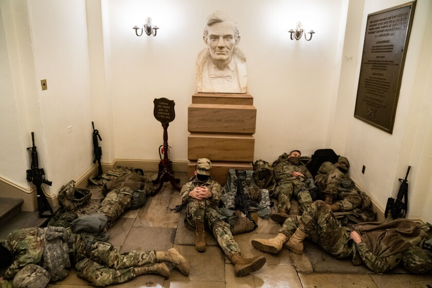 National Guard members sleep on the floor of the U.S. Capitol