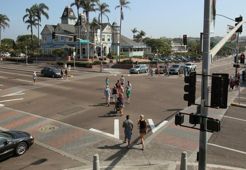 Pedestrians use one of the two new diagonal crossings to cross Carlsbad Boulevard at Carlsbad Village Drive.