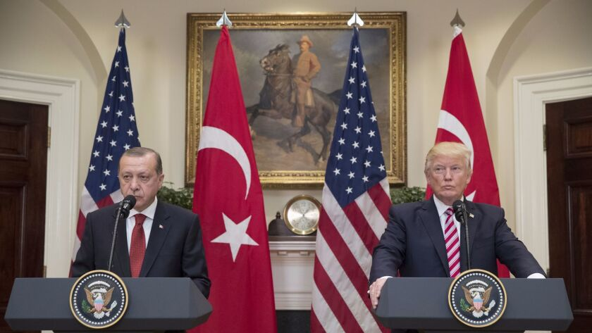 US President Donald J. Trump (R) and President of Turkey Recep Tayyip Erdogan (L) deliver joint stat