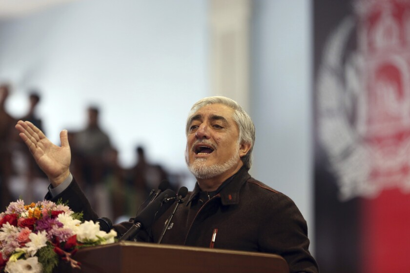 Afghan presidential candidate Abdullah Abdullah speaks to his supporters at a gathering in Kabul, Afghanistan, Sunday, Nov. 10, 2019. Abdullah has unilaterally withdrawn his team's election observers from an official recount of ballots ahead of long-delayed election results. (AP Photo/Rahmat Gul)