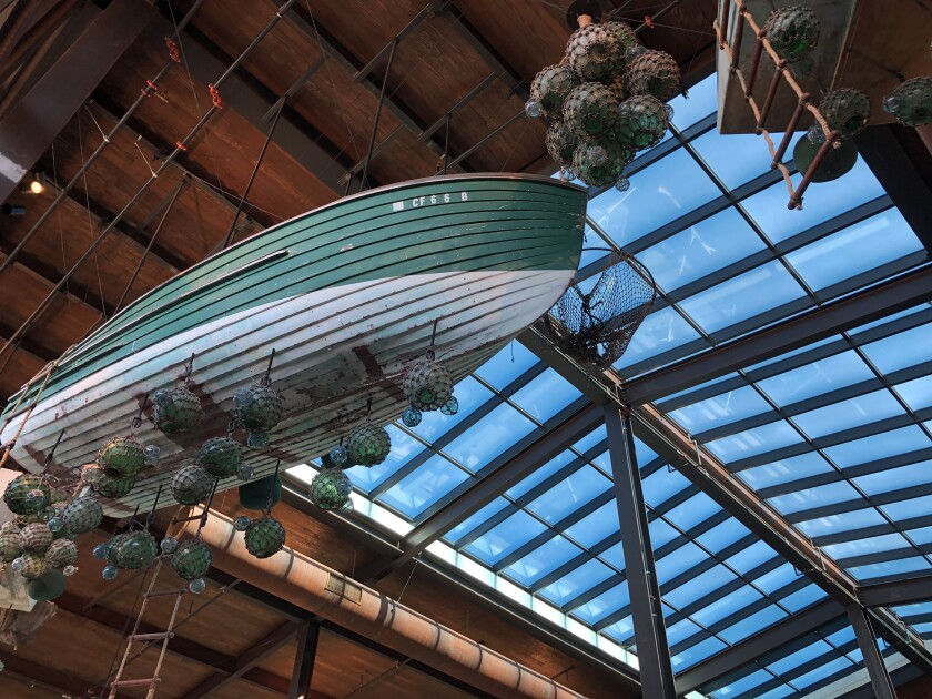 Old boats, fish traps and glass floats hang from the 35-foot ceiling of the Sky Deck.