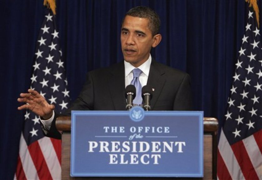 President-elect Barack Obama gestures during a news conference at his transition office in Washington, Wednesday, Jan. 7, 2009, where he introduced Nancy Killefer, not shown, to the newly created position of chief performance officer. (AP Photo/Lawrence Jackson)