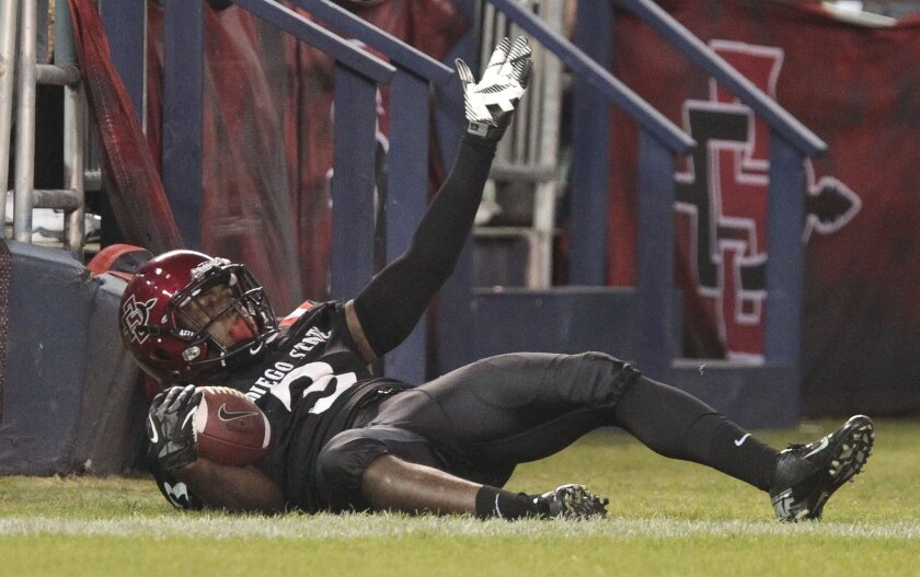 The  Aztecs' Ezell Ruffin comes up with a touchdown pass in the third quarter.