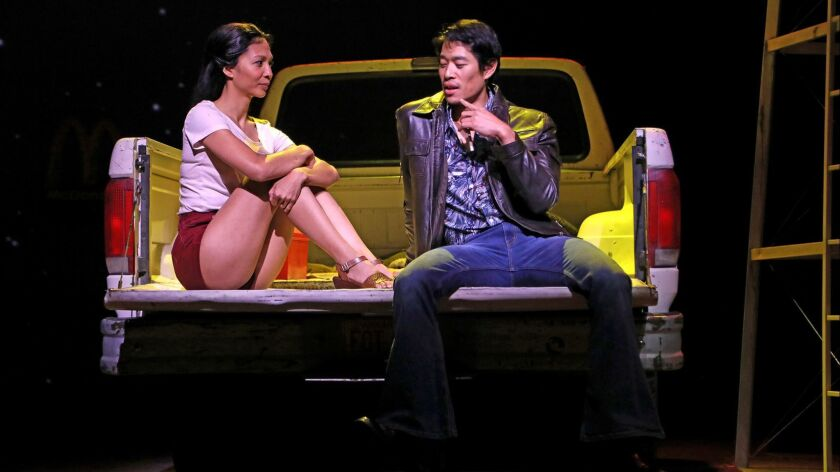 """Maureen Sebastian is Tong, and Tim Chiou is Quang in South Coast Repertory's world premiere production of """"Poor Yella Rednecks"""" by Qui Nguyen."""