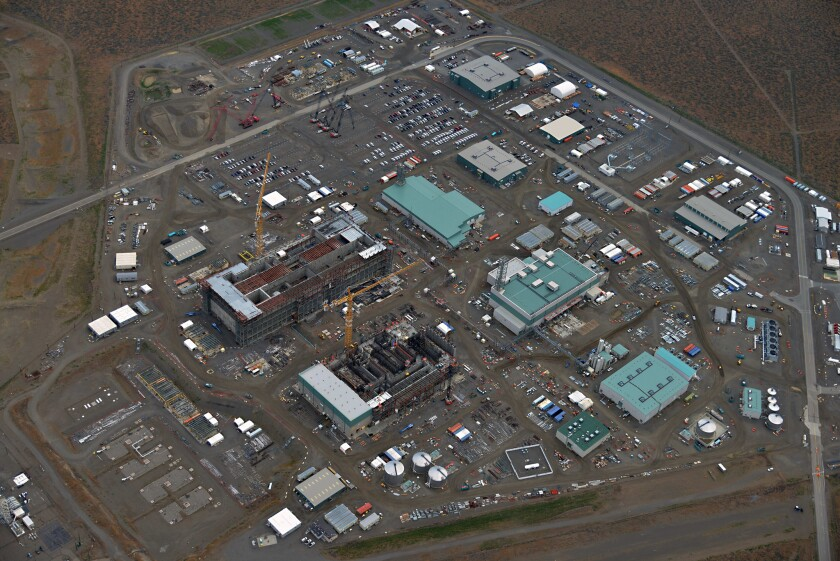 The Energy Department is building an industrial city at its Hanford site in Washington state to transform 56 million gallons of radioactive sludge into solid glass. It is scheduled to begin operating by 2022, but the department wants to push that back to 2039.
