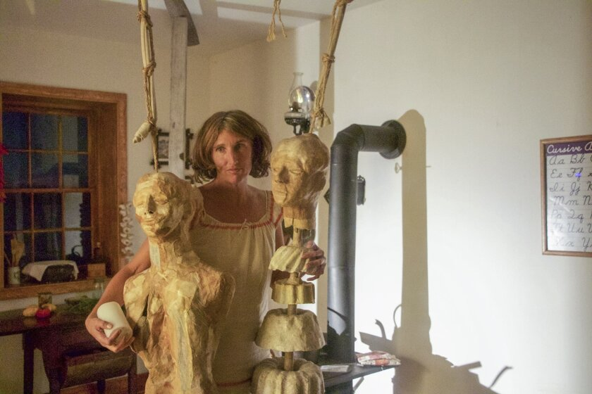 Jenna Ann MacGinnis with figures from 'Kinfolk,' her installation inside the Lighthouse