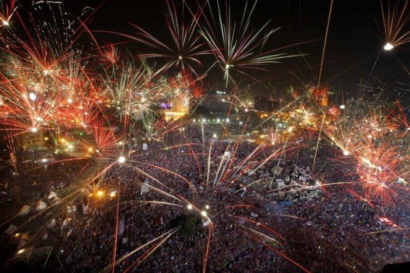 Fireworks light up the sky as opponents of ousted Egyptian President Mohamed Morsi celebrate in Cairo's Tahrir Square.