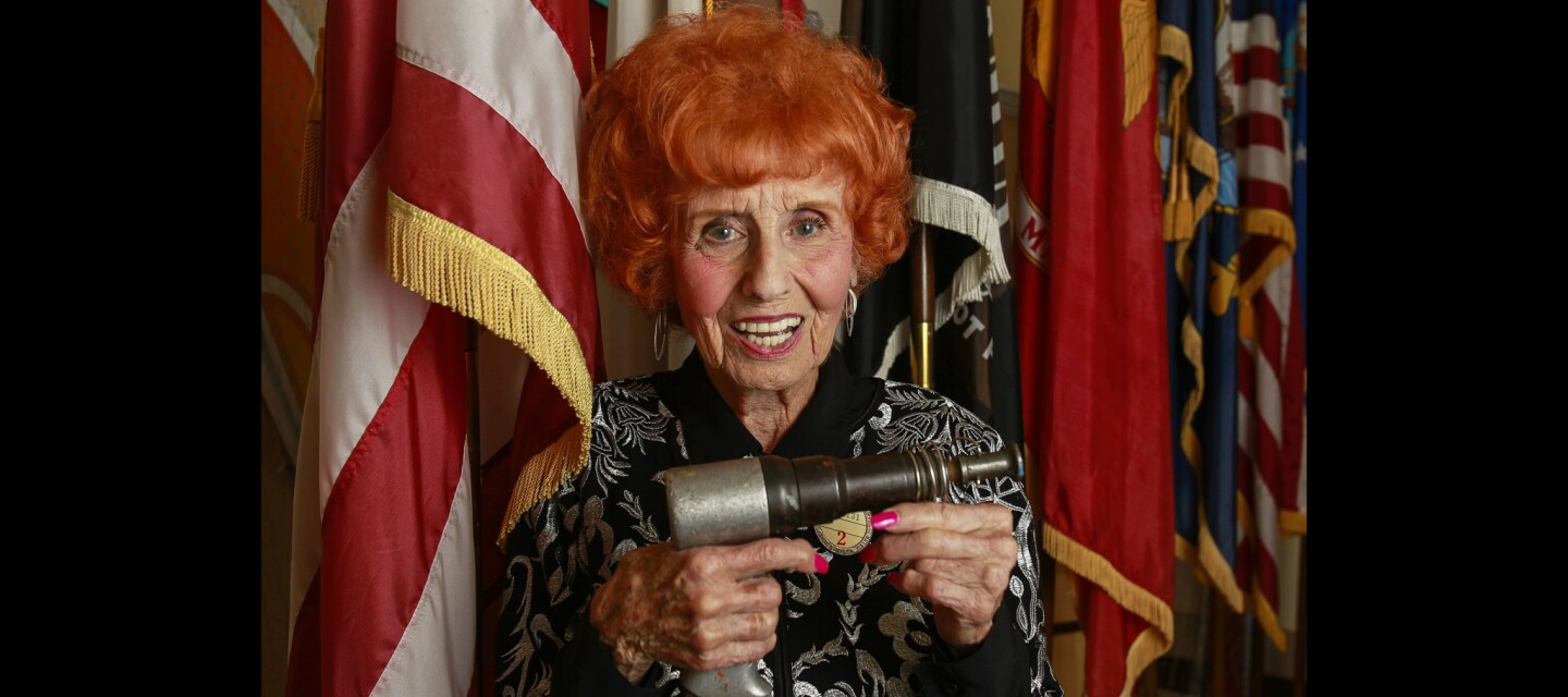 """Elinor Otto, 98, known as the """"Last Rosie the Riveter"""", holds her original riveting gun at the Veterans Home of California-Chula Vista in Chula Vista."""