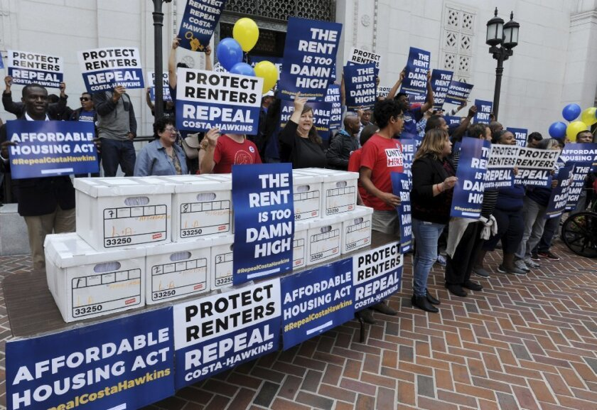 Boxes containing over 588,000 voter signatures for a statewide ballot measure to repeal Costa-Hawkins are shown at a press conference on Monday, April 23, 2018, in Los Angeles. The Costa Hawkins Rental Act of 1995 prohibits rent control in most of California.