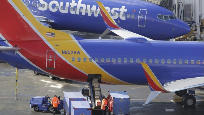 Southwest Airlines planes are loaded Tuesday at Seattle-Tacoma International Airport in Seattle.