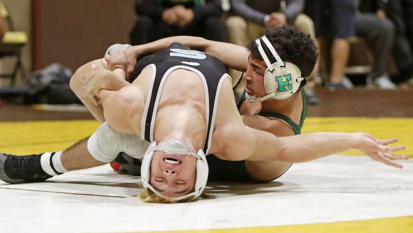 Edison High senior Elijah Palacio, right, competes in a 132-pound match during the first day of the
