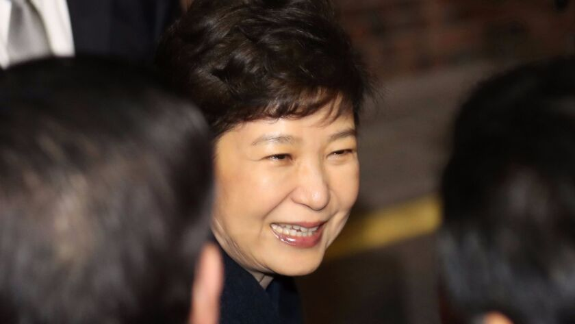 Former South Korea President Park Geun-Hye arrives Sunday at her private residence in Seoul.