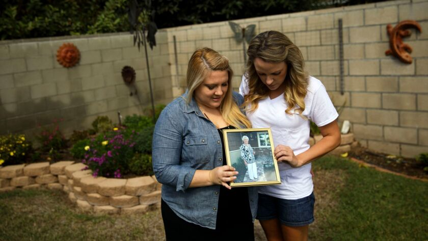 Halie Griffin and sister Katie Howe, grandchildren of grandmother Julie Shepherd (cq) stand for a po