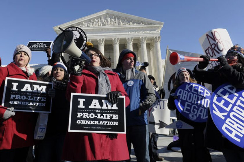 Pro- and anti-abortion protesters rally outside the Supreme Court in January.