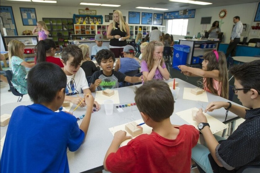 Students participate in a YMCA of Orange County summer learning program at Peterson Elementary School in Huntington Beach in 2017. Local students, parents and teachers turned out at a Huntington Beach City School District study session Tuesday night to oppose possible closure of the school.
