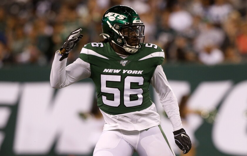 Former New York Jets linebacker Jachai Polite was signed to the Rams' practice squad on Thursday.