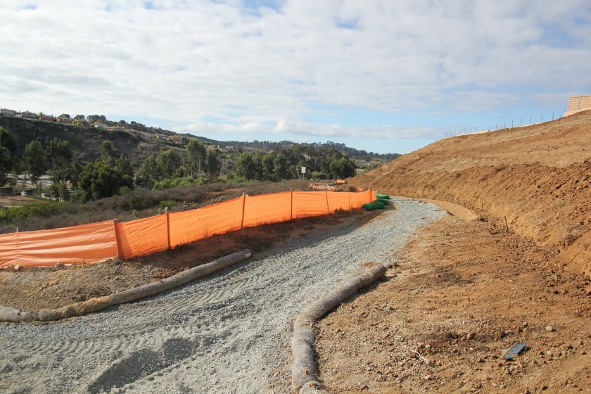 A trail linkage is being built alongside the Alta Del Mar development on Old El Camino Real.