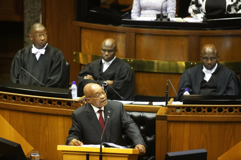 South African President Jacob Zuma give his state of the nation address in Cape Town, South Africa, Thursday, Feb. 11, 2016. Opposition members disrupted the South African president's state-of-the-nation address on Thursday, with some lawmakers walking out of the joint session. (AP Photo/Schalk van