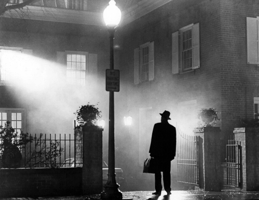 Max von Sydow outside standing under a lamppost at night.