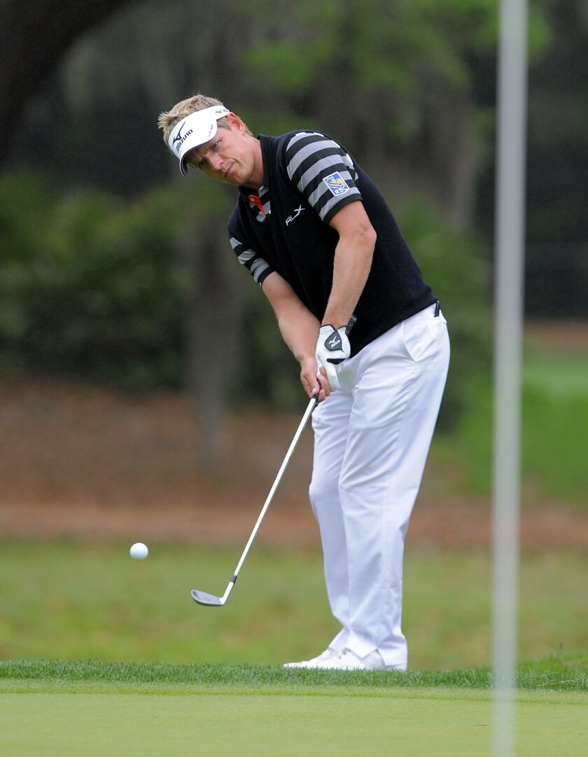Luke Donald, of England, chips onto the seventh green during the third round of the RBC Heritage golf tournament in Hilton Head Island, S.C., Saturday, April 19, 2014. (AP Photo/Stephen B. Morton)