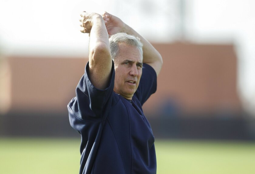 Padres' Bud Black stretches at the Peoria Sports Complex in Peoria, Arizona on Thursday.