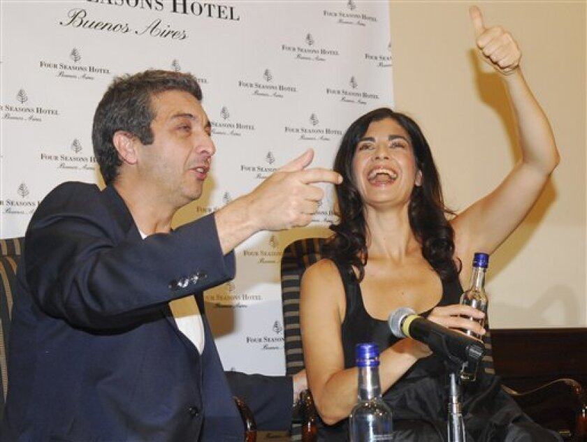 """Argentina's actor Ricardo Darin and actress Soledad Villamil gesture at a news conference in Buenos Aires, Monday, March 8, 2010. Dario and Villamil have the leading roles in the film """"El Secreto de Sus Ojos"""" which was awarded with the Oscar for best foreign language film at the 82nd Academy Awards Sunday. (AP Photo/Stringer)"""