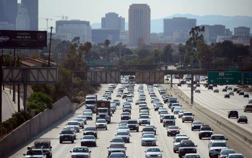 This August 30, 2013 file photo shows motorists as they make their way out of downtown Los Angeles, California.