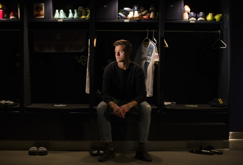 Los Angeles Galaxy soccer player Robbie Rogers in front of his locker at StubHub Center in Carson, Calif.