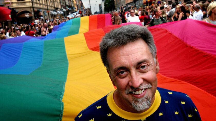 Gilbert Baker heads the 2003 Stockholm Pride Parade, helping to carry an 820-foot-long flag.