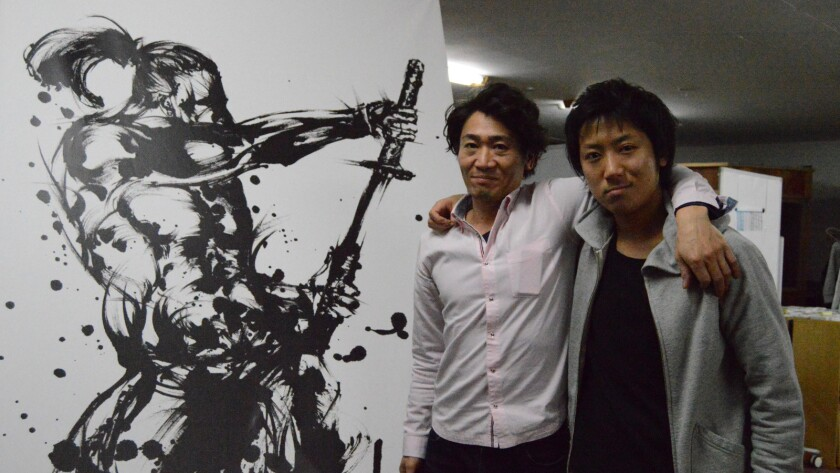 Eiji Yagisawa, 37, an autobike racer-turned-entrepreneur, and Teruma Terakubo, a staff member at a co-working space in Tokyo called Samurai Startup Island.