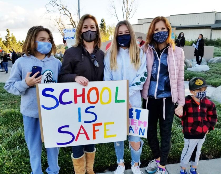 """Henry Kraft, Brenda Kraft, Addie Miller, Jillian Miller and Asher Miller at the """"Let Them Learn"""" rally."""