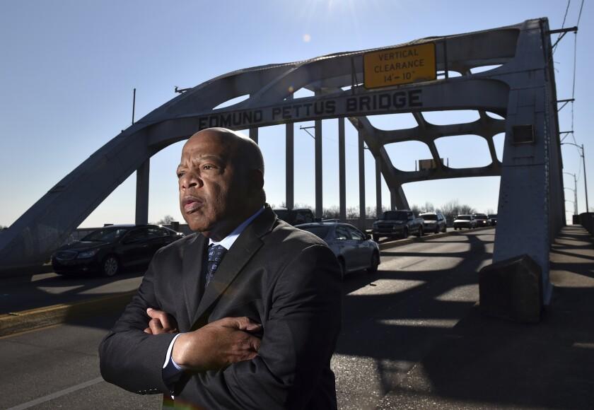 Congressman John Lewis stands on the Edmund Pettus Bridge in Selma in 2015