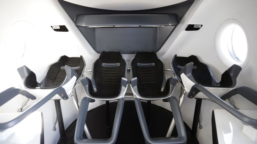 A mock-up of the interior of SpaceX's Crew Dragon capsule.